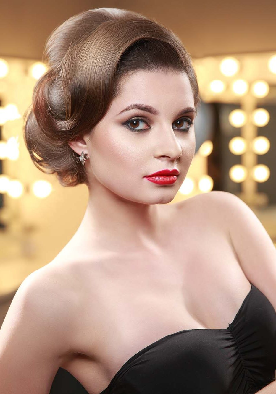 Woman with elegant hair style in evening dress.